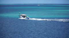 A boat traveling over the South Pacific ocean in French Polynesia. Stock Footage