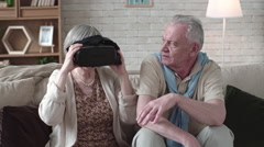 Amazed Elderly Man in VR Headset Stock Footage