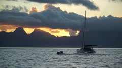 The sunset over Moorea, as seen from Tahiti, French Polynesia, South Pacific. Stock Footage