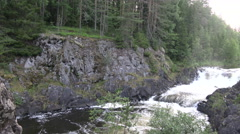 Waterfall on the rocks in wild North. Stock Footage
