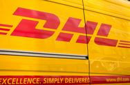 DHL logistic company sign on the delivery van at day time Stock Photos