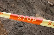 Stop sign ribbon on the construction site Stock Photos
