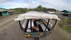 A tour truck driving around the island of Bora Bora, French Polynesia. Stock Footage