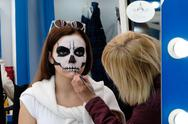 Moscow, Russia - September 10, 2016: Artist applies skull make-up for guest of C Stock Photos