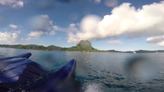 Motor boating in the lagoon at Bora Bora island in the South Pacific ocean in Fr Stock Footage