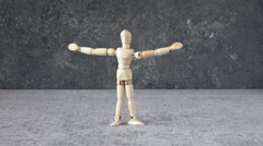 Wooden puppet rising up. Concept film clip of success and victory. Stock Footage