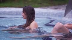 Hot Springs - Man splashing his girlfriend from behind Stock Footage