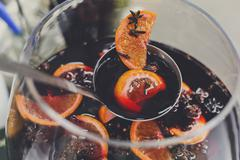Making mulled wine for sale at country fair, closeup Stock Photos