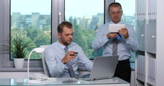 Businessmen Colleague Pay Online with Credit Card Tablet and Laptop Office Desk Stock Footage