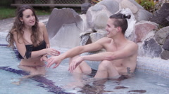 Hot Springs - Woman getting into really warm water Stock Footage