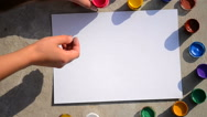 HD 1080 Girl finger paints on white paper Stock Footage