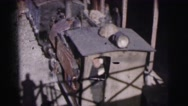 1962: railway station with a train stopped and many passengers BANGKOK Stock Footage