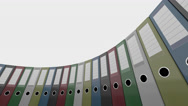 Colorful office binders rotate, low angle wide shot. 4K seamless loop able Stock Footage