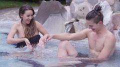 Hot Springs - Woman splashing her man Stock Footage