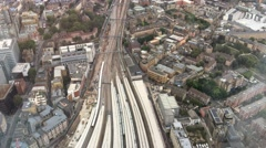 London railway station aerial view with city skyline Stock Footage