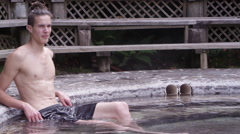 Hot Springs - young man relaxing in tub at spa Stock Footage