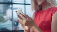 Attractive Smiling Blonde Woman Using Mobile Phone at the Airport Stock Footage