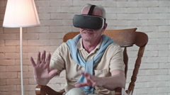 Elderly Man in VR Goggles Touching Air Stock Footage
