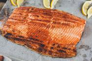 Salmon red fish fillet grilled at barbecue Stock Photos