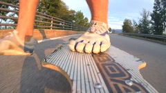 A young man longboarding in the streets. Stock Footage