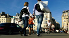 Paris, France. People crossing a bridge on a sunny afternoon. Stock Footage
