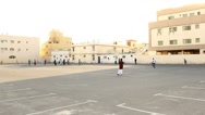 Immigrants workers play cricket game at empty parking lot of the city Stock Footage