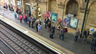 LONDON – People inside a subway station. London subway is a very Stock Footage