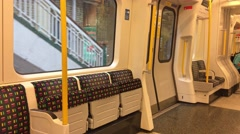 LONDON – Interior of moving subway train. London subway is a Stock Footage