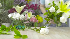 Dolly shot of florist woman arranging a beautiful bouquet with white flowers Stock Footage
