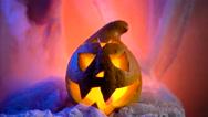 Scary Halloween Pumpkin looking through the smoke. Glowing, smoking monster Stock Footage