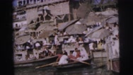 1962: many people are in a village by water and some boat away DARJEELING Stock Footage
