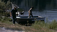 Canada 1970: people leaving the boat and going to their van Stock Footage