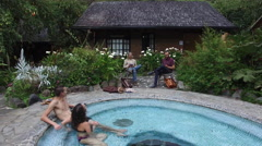 Hot springs tub - group on vacation aerial Stock Footage