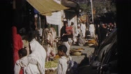 1962: a busy street with people shopping and vendors showing their wares Stock Footage