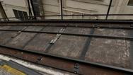 Steel rope on rail road. Part of funicular railway, hawser move slightly swing Stock Footage