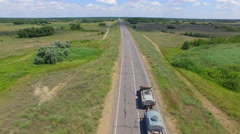Big truck driving on the highway. aerial view Stock Footage