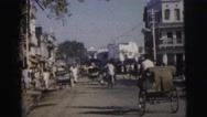 1962: busy street with cyclists, pedestrians, buses, rickshaws etc DARJEELING Stock Footage