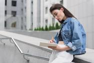 Young fashion designer sketching outdoors Stock Photos