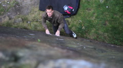 A young man rock climbing bouldering. Stock Footage
