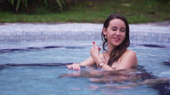 Hot Springs Woman in pool alone Stock Footage