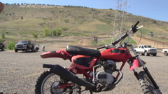 A young man in an orange hat riding a motocross bike. Stock Footage
