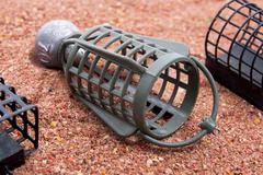 Close up view of fishing feeder. Dry feed for carp fishing as background for Stock Photos