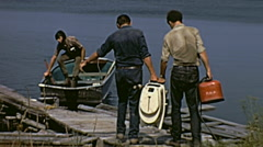 Canada 1970: people assembling the engine on a boat Stock Footage