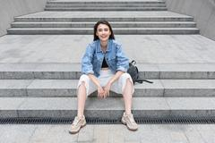 Modern and optimistic single lady resting on the street Stock Photos