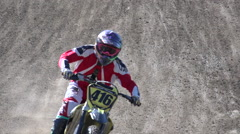 A young man riding a motocross dirt motorcycle. Stock Footage