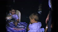 1951: 3 children and 2 adults around a birthday cake CLEVELAND, OHIO Stock Footage