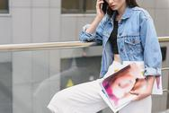 Woman with drawings standing outdoors Stock Photos