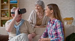 Laughing Grandfather in Virtual Reality Glasses Stock Footage