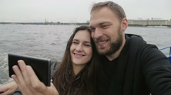 Happy couple in love, smiling, taking selfie. Loving couple uses smartphone to Stock Footage