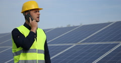 Caucasian Engineer Man Passing Call Discussion Talking Phone Photovoltaic Cells Stock Footage